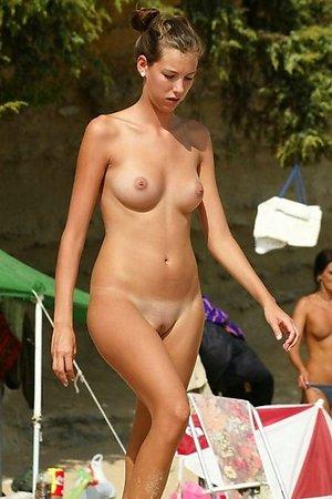 lovely female nude chicks enjoys nudist life in the Crimea on the beach