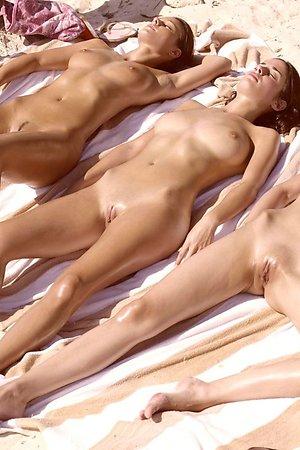 Nude beach and their spread legs