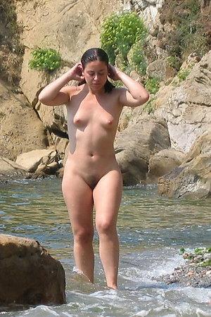 Naked nudist girl on beach photos