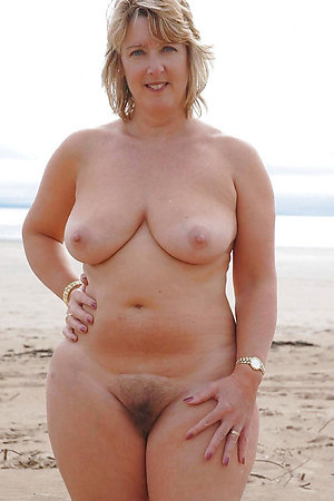 Pure mature naturists on a nudist beach
