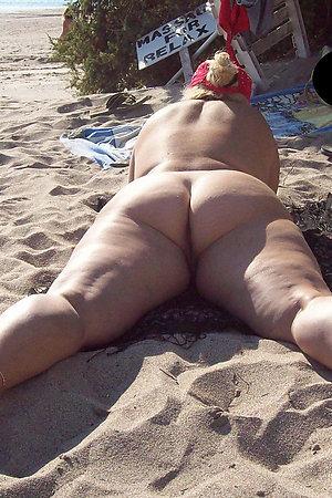 Fat nudist moms and grannies sunbathing nude on beach