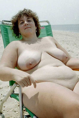 Chubby mature dames sunbathing on a nudist beach