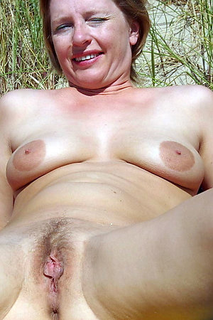 Mature naturist ladies on a picnic