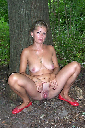 Nudist mature ladies in a trees