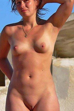 A hot slut posing at theCosta Natura