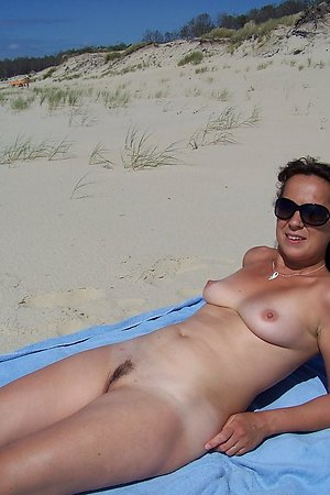 A bikini babe going topless on the Tulum