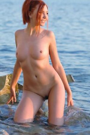 Naked amateurs posing on a beach
