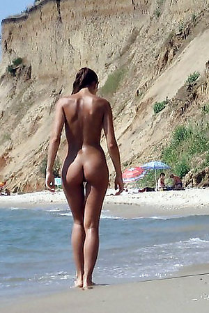 Sexy nude girls and men on the nudist beach