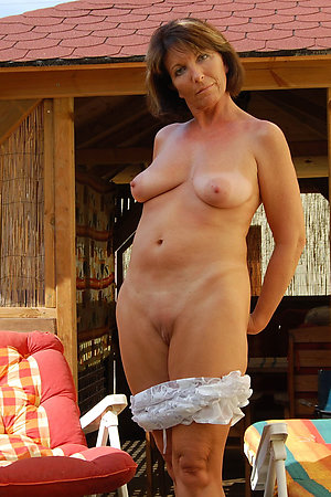 Mature women pulling down their panties outdoors