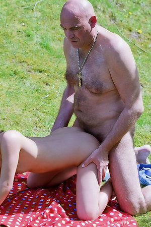 Nudists of different age having nude time together