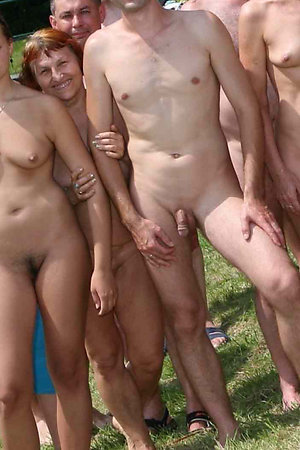 Naked picnic of nudists with different ages