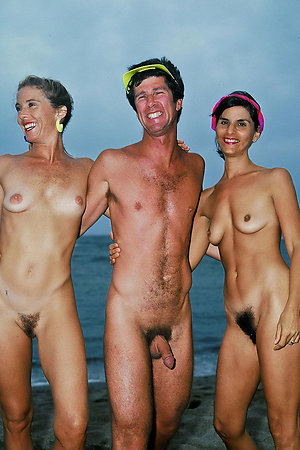 Nudists of different age photograph together