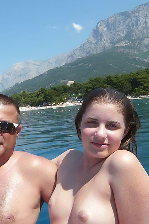 Older naturist men with younger naturist girl