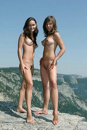 good looking young damsels disclaims swimwear on the beach