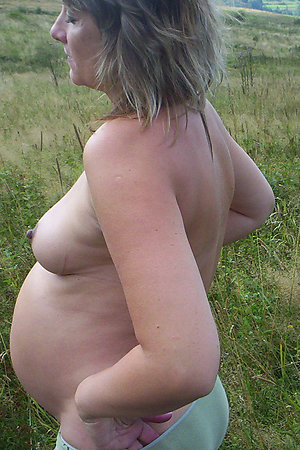 Young pregnant naturist girls posing outdoors