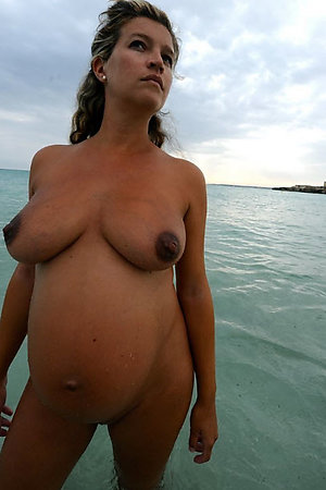 Naturist pregnant women staying nude in water