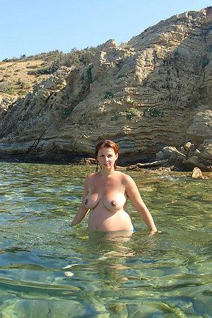 Nudist pregnant women on a seashore