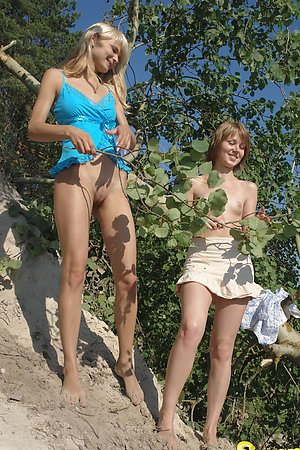 Two teenage amateurs stripping each other and posing nude in the sun