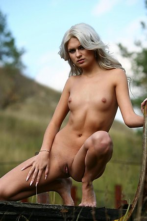 Hot looking blonde showing her perfect body outdoor in the sun