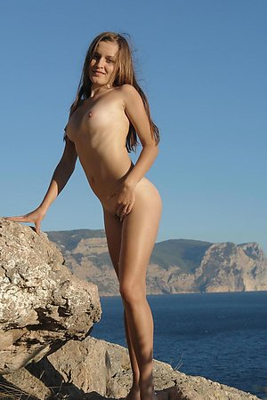 Barely legal amateur enjoying her vacation nude at the sea