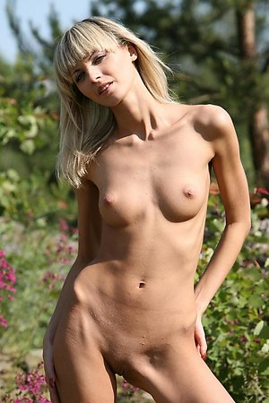 Skinny blonde chick showing every inch of her sunbathed body