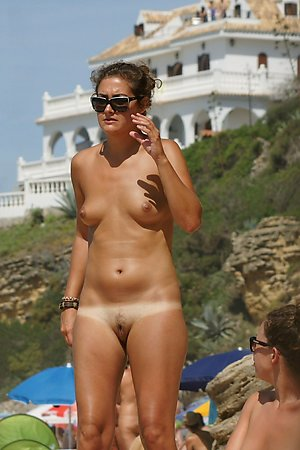 Still more sexy nude woman, tanned body, wife at nude beach at at nudist beach